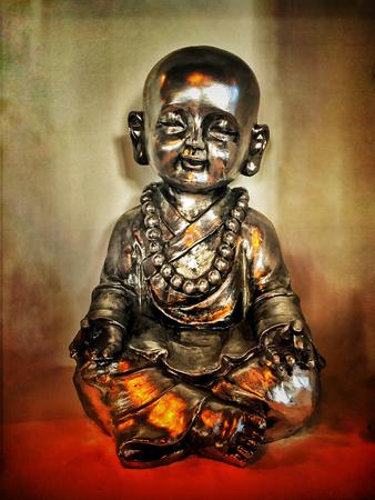 Retro Grunge Buddha Sculpture and Candle Light