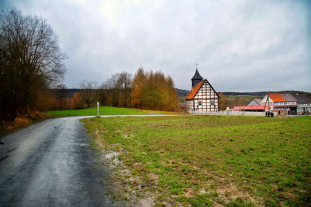 Green Grass near Road and German House Photo