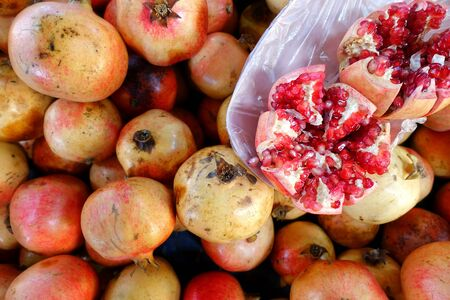 Red Juicy and Helathy Fruit Pomegranate in Grocery