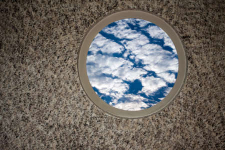 Soft Clouds on Blue Sky on the Window Photo