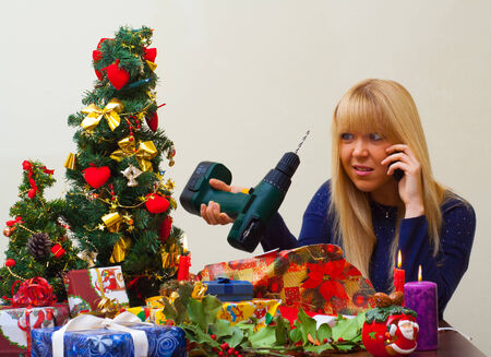 girl disappointed over christmas gift speaking over the phone photo
