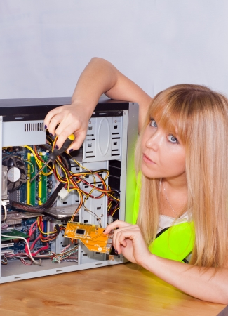computer model: smart girl fixing a computer