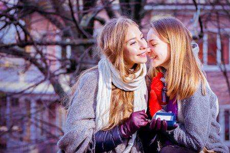 two girls hugging: best friends forever, two girls hugging and smiling togethr