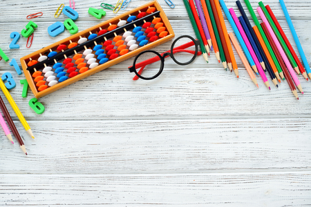 Colorful back to school supplies top border over white table. Mental arithmetic. Space for text. Reklamní fotografie