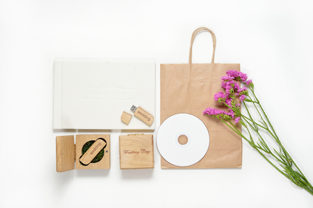 Craft photography packaging beautiful white wedding photobook, Usb flash drive in Handmade wooden box, cd disk. photo frame, wedding concept Stock Photo