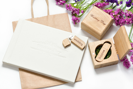 Original gift present. Beautiful white wedding photobook and Usb flash drive in Handmade wooden box. wedding concept Stock Photo