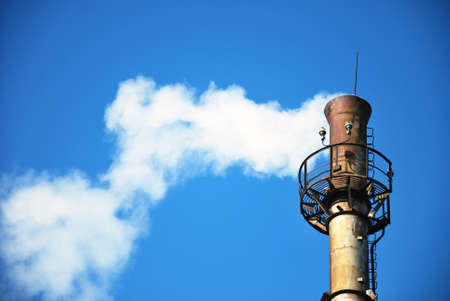 white smoke against a background of blue sky photo