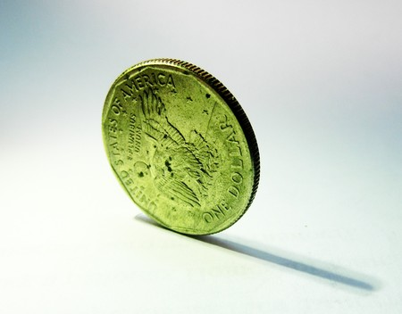 coins shot in golden color: one dollar coin