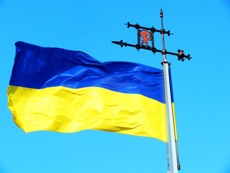 flaunt: Ukrainian flag with the coat of arms of Lviv Stock Photo