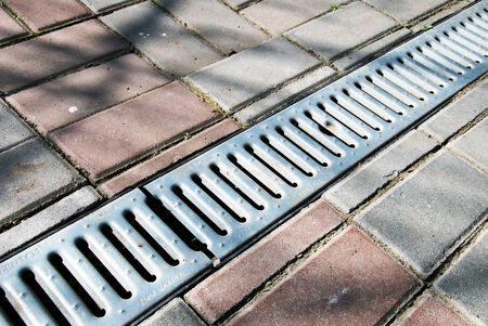 metal grate: Weathering for water in a court