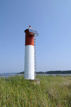Sidney Spit lighthouse at the end of the spit, Gulf Islands National Park Reserve of Canada, British Columbia, Canada