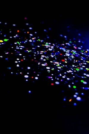Colorful lights blurred glitter background. Abstract illuminated texture. Christmas, new year or birthday celebration. Night life photography Stock Photo