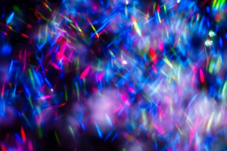 Colorful lights blurred glitter background. Abstract illuminated texture. Christmas, new year or birthday celebration. Night life photography Stockfoto