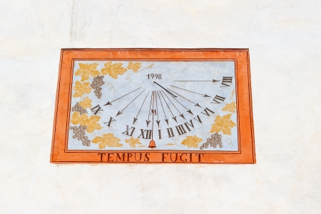 In the past, men used sun and shadows to indicate the exact time, sundial was one of the first wall watches in history photo