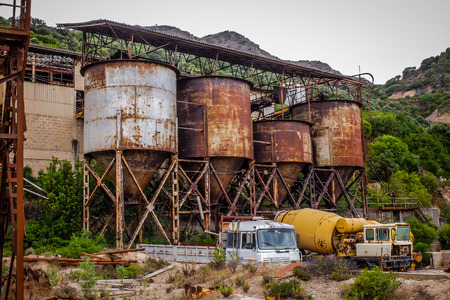 infrastructures: Rusted infrastructures of an abandoned mine are exactly as they were left on the day the activity stopped in the  80s