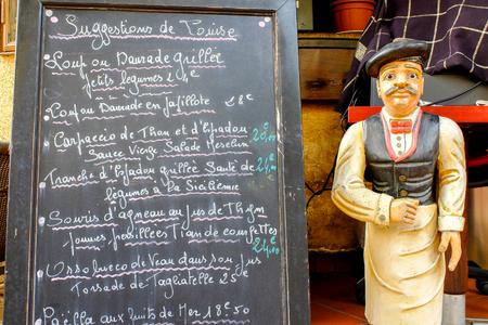 singular: A singular menu table in a French Riviera restaurant