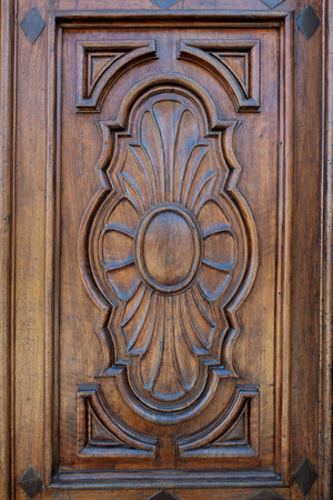 hardly: Close up of the door of a Catholic Church, handmade from wood and hardly inlaid Stock Photo
