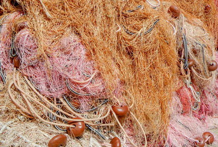 floaters: Some fishnets create a pleasant colored composition with warm colors. Closeup allows to see the buoys and the details of the nets. Stock Photo