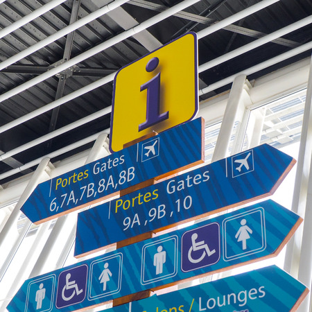 lounges: Airport informations signs for passengers, showing gates, toilets and lounges.
