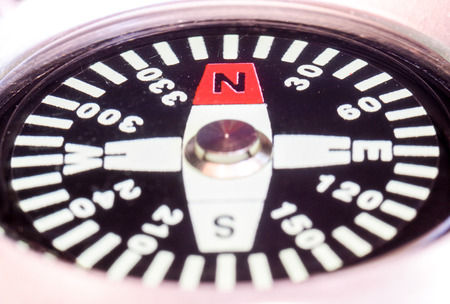 north arrow: Closeup view of the screen of a compass with North direction indicating by red arrow Stock Photo