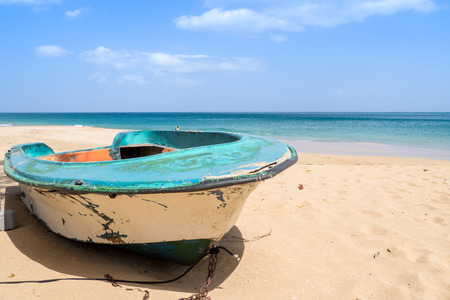 perle: On the beach of La Perle, Guadeloupe, old boat abandoned in the sand Stock Photo