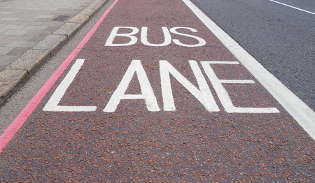 public transportation: Traffic signs indicating lane reserved to buses and public transport means on a London street