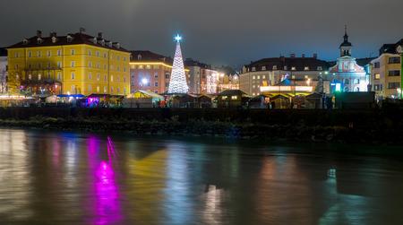 inn: Night shot of Innsbruck Christmas Market in Marktplatz, viewed by Inn river bank