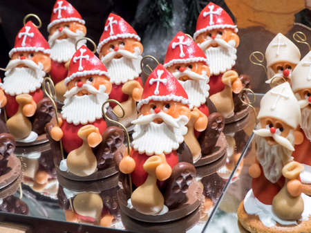 patisserie: In a patisserie window, several examples of chocolate sweets with features of Santa Claus