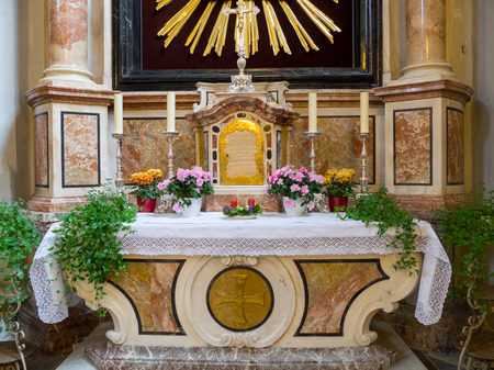 christian altar: Altar ornated with flowers and candles inside a catholic church in Austria, Christian religion. Stock Photo