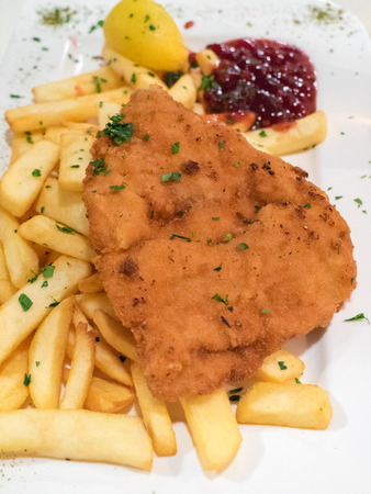 wiener: Breaded meat served with french fries, typical dish in Austria called Wiener Schnitzel.
