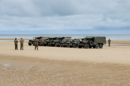 anniversary beach: Omaha Beach, France, June 4th 2014: people and military vehicles at Omaha beach to celebrate the anniversary of d-day allied debarquement in Normandy. Editorial