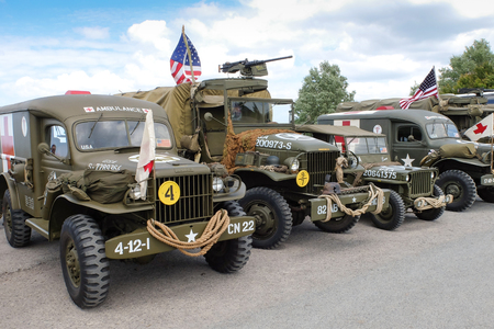 deployed: Longues sur Mer, France, June 5th 2014: old military vehicles deployed on Normandy coast during D-day anniversary commemorations.