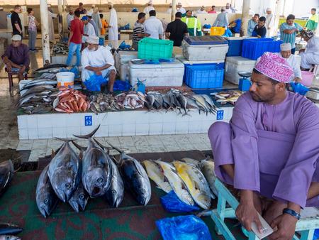 muttrah: Muscat, Oman, 12 March 2017: fish market at Muttrah, town center of Muscat, Oman. Several tuna and other fish on stalls. Editorial