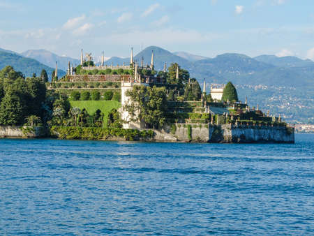 Complex gardens of a villa of isola Bella, major island of Maggiore Lake in Northern Italy, at sunset