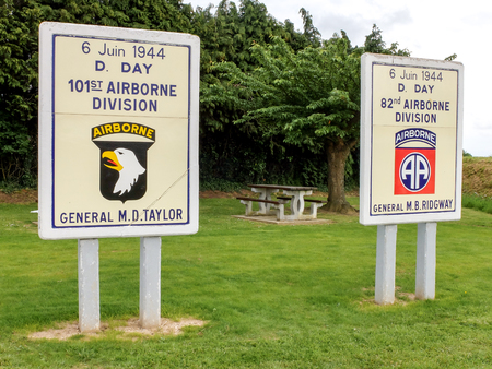 Sainte Mere Eglise, France, June 3rd 2014 - At the entrance of Sainte Mere Eglise town, in Normandy, two panels honor the memory of American Army airborne divisions that landed during the D-Day.