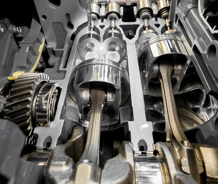 Inside view of modern engine, close up detail of two pistons in cylinder with four valves,some gears aside. Stockfoto