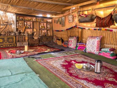 Bedouin tent interior in Oman desert village, Wahiba Sands