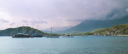 Boats in the bay with the mountains photo