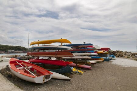 south platte river: lots of colorful kayaks on the beach