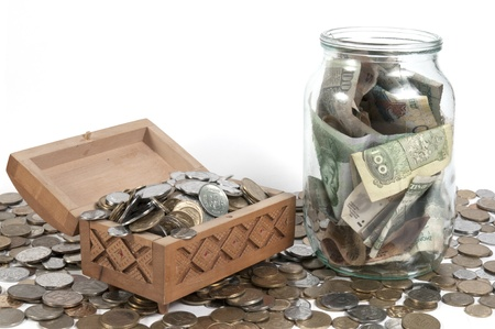 The box with coins on isolated background Stock Photo - 21766783