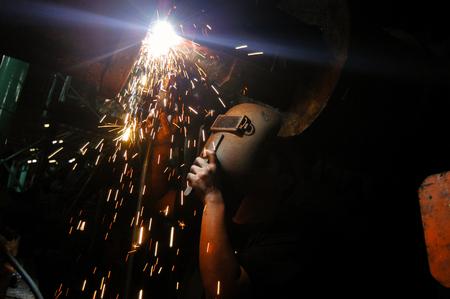 man working welder Фото со стока