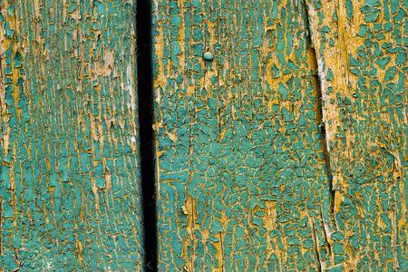 old peeling paint on wooden planks