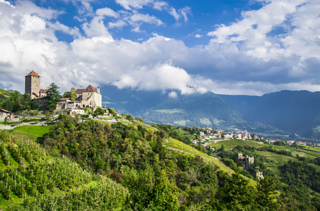 meran: Idyllic rural landscape with a castle and vineyards. Merano, South Tyrol, Italy
