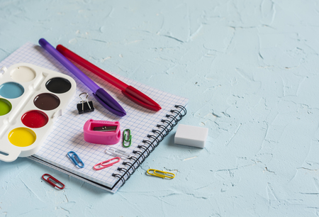 free education: School supplies on blue background. Free space for text