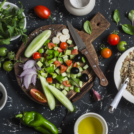 Ingredients for salad - quinoa and vegetables  on a dark background. Delicious vegetarian food Archivio Fotografico