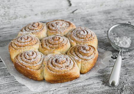danish: cinnamon rolls on bright wooden surface