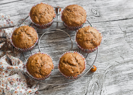 Oatmeal and banana vegan muffins on rustic light wooden board. Healthy food Stock Photo