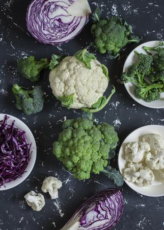 Variation of fresh cabbage -  broccoli, cauliflower, red cabbage. On a dark background, top view Archivio Fotografico