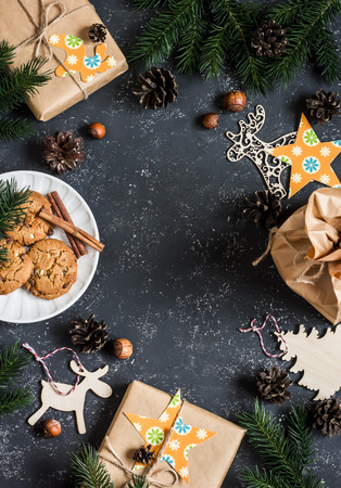 free christmas background: Christmas background. Christmas gifts, decorations, cookies, christmas tree. On a dark background, top view. Free space for text. Flat lay