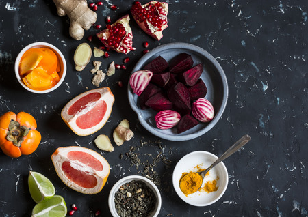 elixir: Ingredients for cooking beet and ginger detox elixir. On a dark background, top view